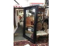 Large black mirror.