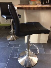 Black leather and stainless steel swivel bar stools, adjustable height