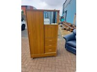 brown wood wardrobe with glass doors and 3 drawers at the bottom