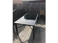 6 person Gloss black glass garden table with lazy Susan