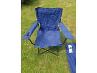 Five blue folding camping chairs