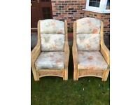 Set of two large comfortable wicker chairs with fitted cushions