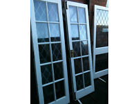 Exterior wooden double doors with double glazed glass (3 paynes have misted up)