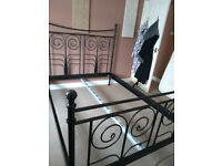 wrought iron bed frame with wooden slats