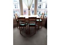 Dining/kitchen table with 4 chairs. Very good condition.