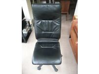 Black leather executive office chair, high back. Very comfortable