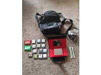 Red Nintendo DS with charger and case and 19 games including 3 Pokemon