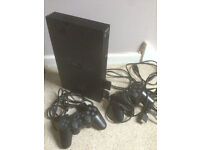 Sony Playstation 2, memory cards, two controllers and leads