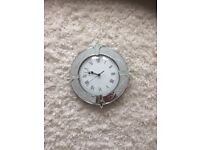 Lovely glass wall clock in excellent condition.