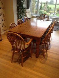 """Pine Dining Table 39"""" X 66"""" with 8 chairs (2 are Carver Chairs) all with detachable cushions."""