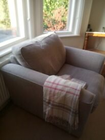 Light grey very comfortable armchair in new condition