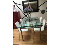 Stylish white leather dining chairs x 4