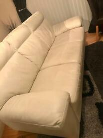 Cream leather sofas