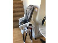 High chair different heights with activity trays good condition