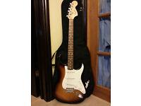 Sunburst Squier Stratocaster electric guitar