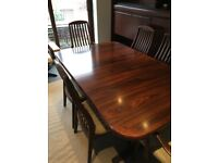 Beautiful Rosewood Dining table and 6 Chairs. In excellent condition.
