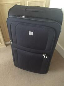 Very large Tripp suitcase