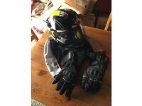 Motorbike helmet, bag and gloves.