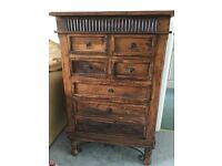 Indonesian dark wood cabinet and tall drawer unit