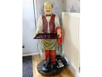 butler figure with small tray