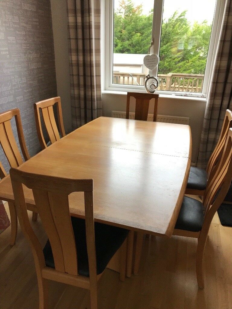 Oak dining table and 6 oak chairs from sterling furniture