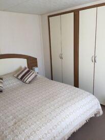 Lovely 6 berth caravan at Heacham beach park dean ,prime riverside pitch , king size ensuite bedroom