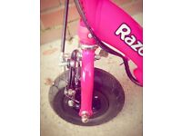 Pink razor scooter electric great condition comes complete with charger