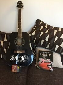 Guitar for beginners with learning chord cards, song book and tuner.