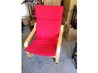 Ikea POANG armchair. Red fabric and light wood structure. Good condition.