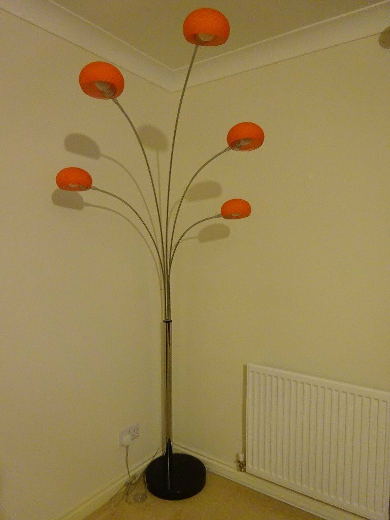 Modern floor light with orange shades