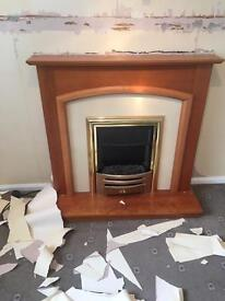 Electric fireplace with working heater
