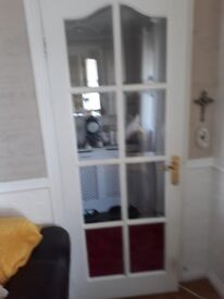 4 white panelled doors and one parial glass door