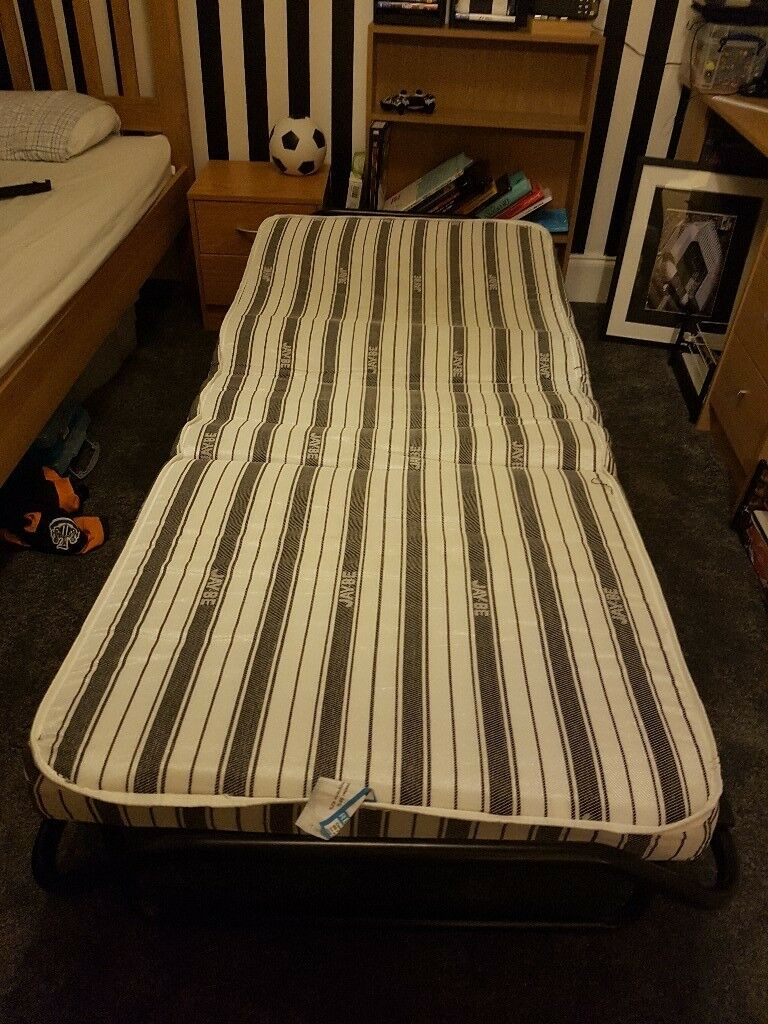SINGLE camp bed folds up lightweight £40 immaculate condition