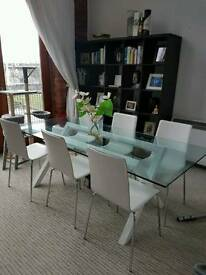 Glass dining table with 6 chairs