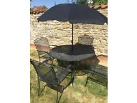 JOHN LEWIS KETTLER, LARGE GARDEN TABLE, 4 CHAIRS AND PARASOL