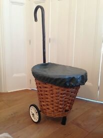 Stylish shopper. Wicker basket shopping trolley with waterproof cover. Excellent condition. Cost £90