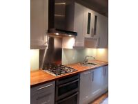 Neff kitchen appliances, electric double oven, gas hob and extractor fan .