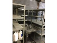 10 HEAVY DUTY METAL SHEVLES/RACKS. REALLY STRONG AND IDEAL FOR WAREHOUSE OR GARAGES.