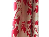 Red floral pattern curtains.
