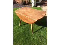 Ercol dining table, round, damaged
