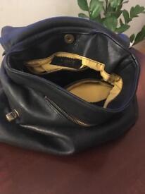 Black bag with yellow fabric interior