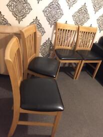 4 Black leather and Wooden chairs for sale