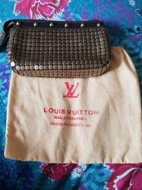 A beautiful ladies lv cluch handbag