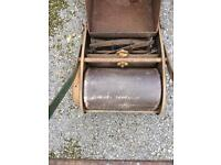 Antique lawn mower wil need a service