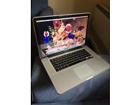"Macbook Pro 15"" 8GB + lots of Software; Adobe Photoshop, Premiere Pro, Final Cut Pro + Logic Pro X"