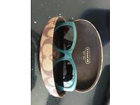 Coach Sunglasses. With case. Good condition. Worn a few times. Jade green & bang on trend