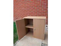 Cupboard with two doors in an oak veneer finish in excellent condition - £10