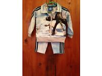 Genuine adidas tracksuit size 3-6 months.