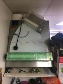 Pizza machine roller