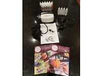 Cassie Brown airbrush kit with cleaning jar and 2x DVDs. Excellent condition.